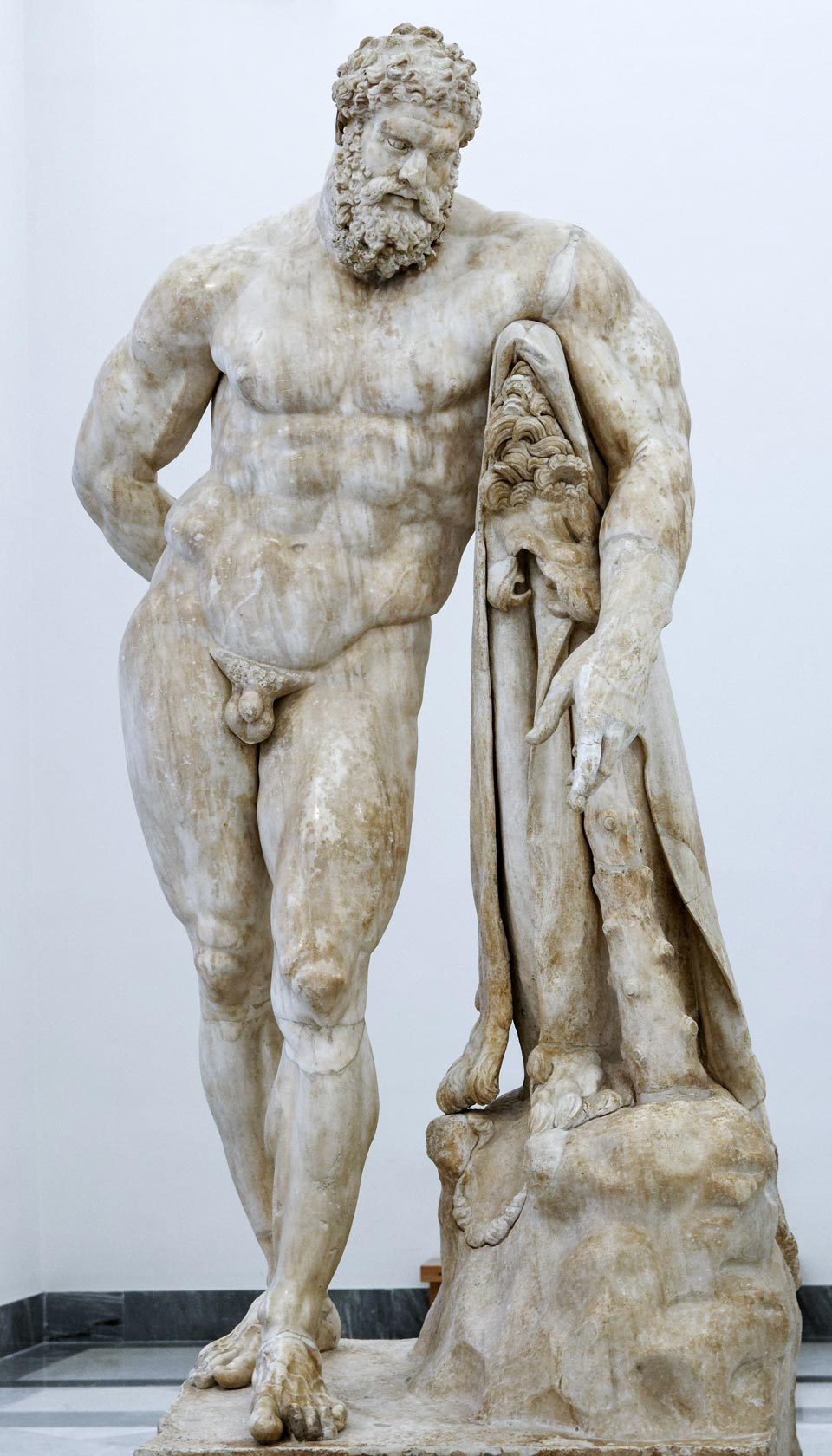 replica of the farnese's hercules of the national archaeological museum of naples in white carrara marble. The huge marble sculpture is now available for sale at bazzanti art gallery florence.
